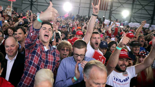 Supporters cheer for Donald Trump during a campaign rally at the Airborne Maintenance & Engineering Services hanger November 4, 2016 in Wilmington, Ohio.