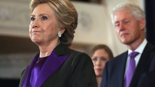 Former Secretary of State Hillary Clinton, accompanied by her husband former President Bill Clinton, pauses as she concedes the presidential election at the New Yorker Hotel on November 9, 2016 in New York City.
