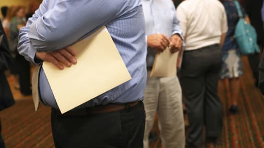 People wait to speak with potential employers at a job fair in Hartford, Connecticut.