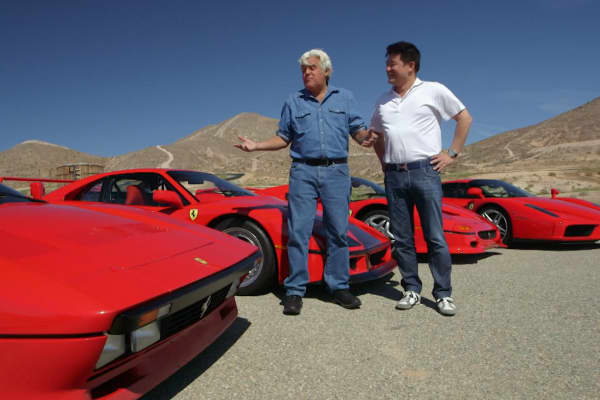 Jay Leno checks out the Ferrari collection of David Lee.