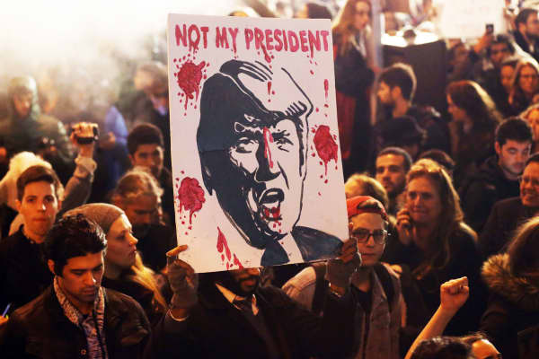 Protestors gather outside Trump Tower in New York during a protest against President-elect Donald Trump on November 9, 2016.