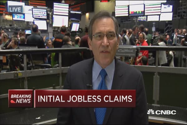 Weekly jobless claims down 11,000 to 254,000