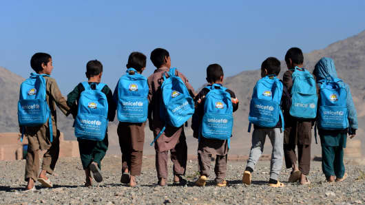 Afghan children walk to school on the outskirts of Herat on October 10, 2016.