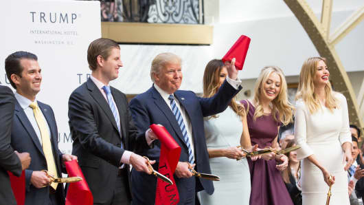 In the grand lobby of Trump international Hotel, (l-r), Donald Trump Jr., Eric Trump, U.S. Presidential candidate Donald J. Trump, Melania Trump, Tiffany Trump, and Ivanka Trump, cut the ribbon for their latest property, Trump International Hotel - Old Post Office, in Washington, DC on October 26, 2016.