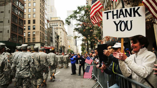 People cheer veterans in the Veterans Day Parade in New York City last year.