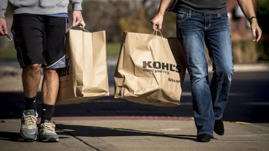 Shoppers carry Kohl's bags in Chicago.