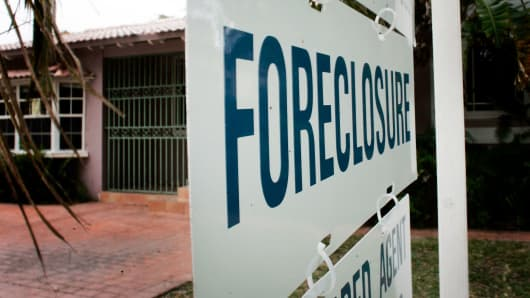 A foreclosure sign in front of a house in 2007.