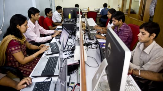 Software programmers work on computers in Mumbai, India