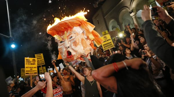 Protesters burn an effigy of Donald Trump outside Los Angeles City Hall.