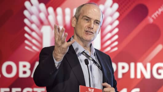 Michael Evans, co-president of Alibaba Group Holding Ltd., gestures as he speaks at a news conference during the company's annual November 11 Singles' Day online shopping event in Shenzhen, China, on Friday, Nov. 11, 2016.