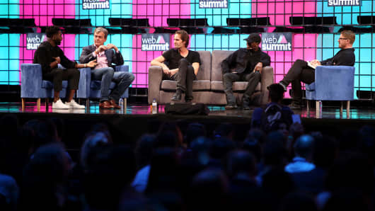 British musician Tinie Tempah speaks as Hans-Holger Albrecht, CEO of Deezer, US musician Ne-Yo and Eric Wahlforss, Co-Founder & CTO of SoundCloud listen, during the Web Summit in Lisbon, Portugal on November 10, 2016