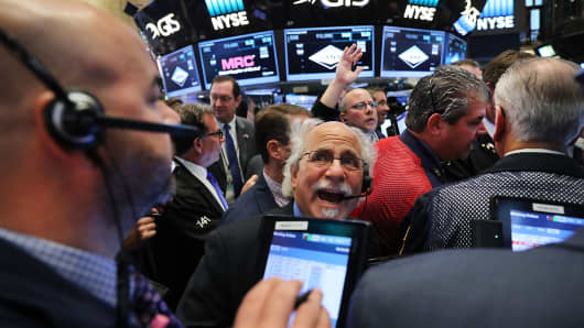 Traders work on the floor of the New York Stock Exchange the morning after Donald Trump won a major upset in the presidential election on November 9.