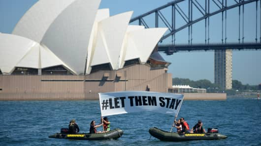 Greenpeace members unfurl a sign protesting the detention of asylum seekers who arrive in Australia by boat. The February 2016 protest was one of many held against the country's tough border protection policies.