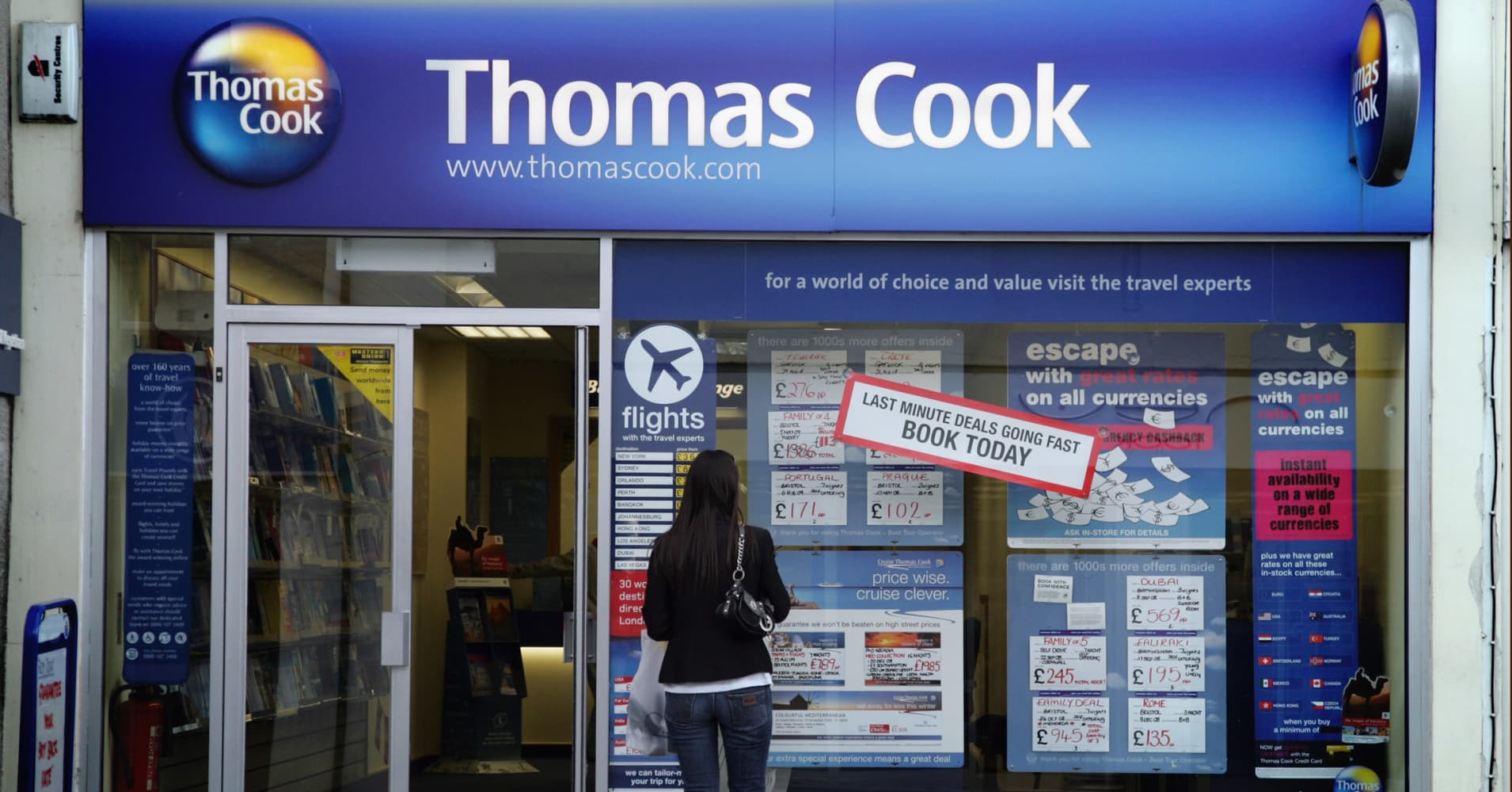 Thomas Cook cuts profit forecast again due to weak British market