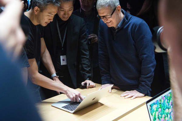 Apple CEO Tim Cook previews a MacBook Pro