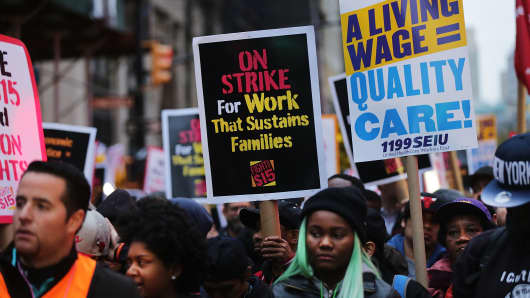 Low wage workers and supporters protest for a $15 an hour minimum wage.