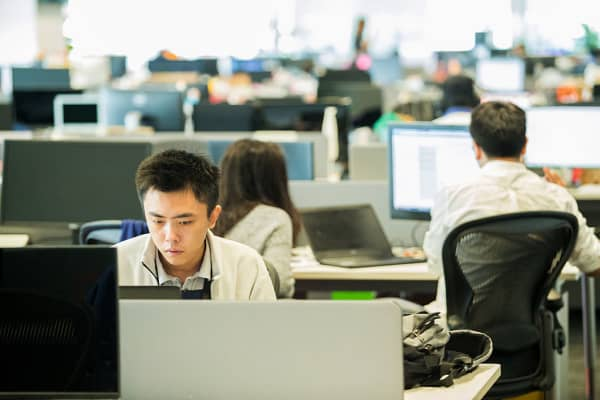 Employees work at the headquarters of Garena Interactive Holding, a gaming and e-commerce company, in Singapore.