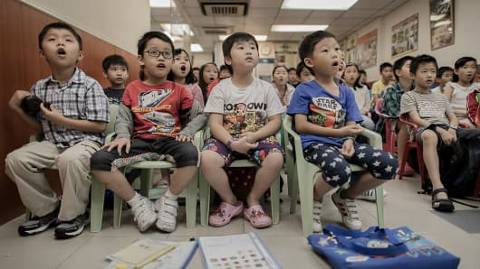 Children attend a class to learn how to speak English with an American accent in Hong Kong.