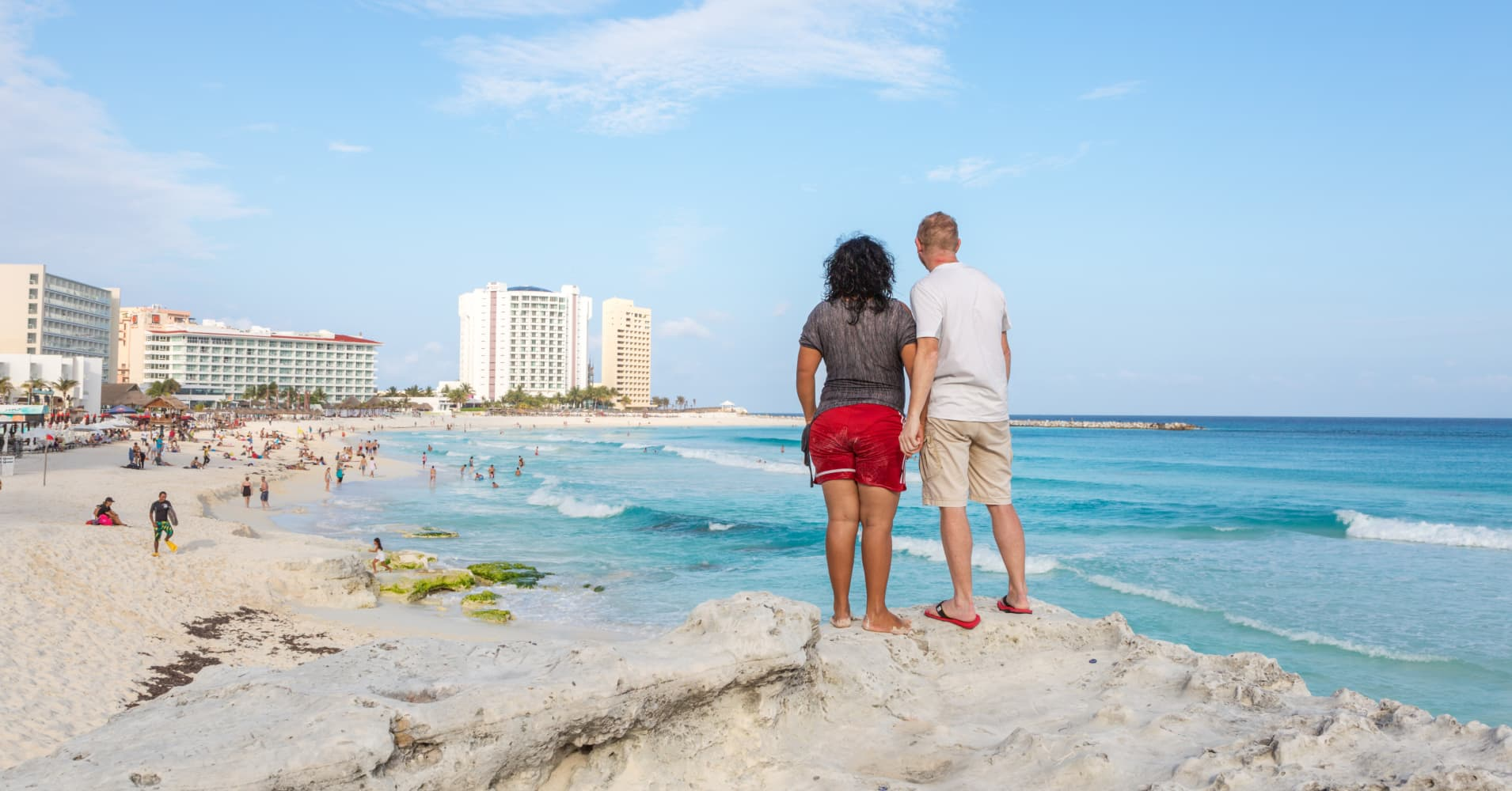 Tourist couple looking at Gaviota Azul beach, Cancun, Quintana Roo, Mexico.