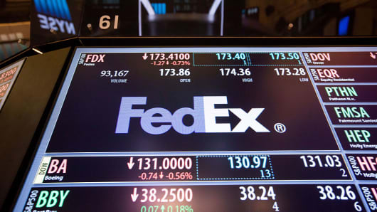 FedEx Corp. signage is displayed on a monitor on the floor of the New York Stock Exchange (NYSE) in New York, U.S., on Monday, Oct. 3, 2016.