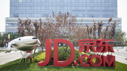 JD.com headquarters logo sign outside building in South section of Beijing, May 19, 2016.