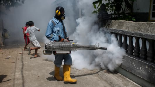 A health worker fumigates densely populated areas to prevent the spread of Aedes aegypti and possible spread of the Zika virus in Lhokseumawe, Aceh province, Indonesia, on Sept. 16, 2016.