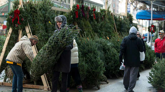 A resident of Manhattan's Upper West Side purchases a Christmas tree from a street vendor.