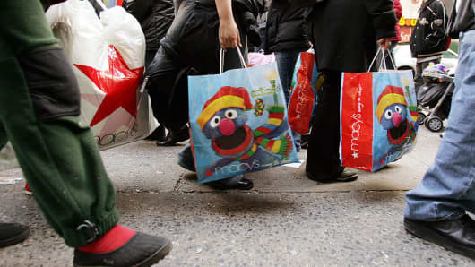 Shoppers carry bags outside Macy's department store in New York City.