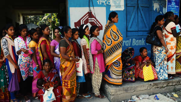 Here's why long lines are forming outside of India's banks