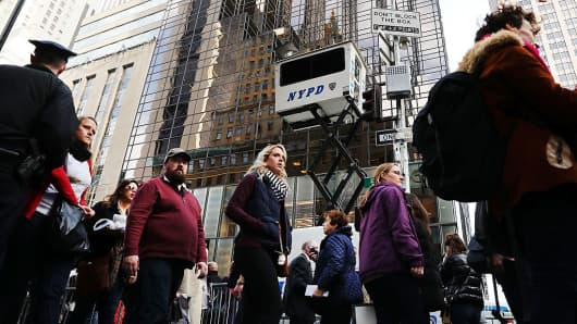 Pedestrians walk by new police security posts outside of Trump Tower that have been installed since Donald Trump became the president-elect on November 14, 2016 in New York City.