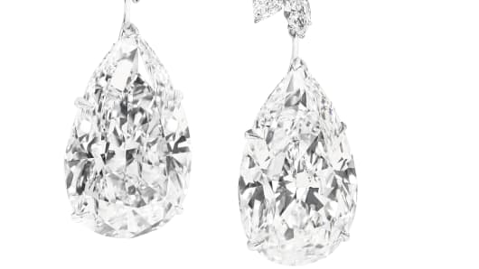 Miroir de l'Amour: A pair of pear-shaped, D colour, flawless diamond earrings, weighing 52.55 cts and 50.47 carats, by Boehmer et Bassenge
