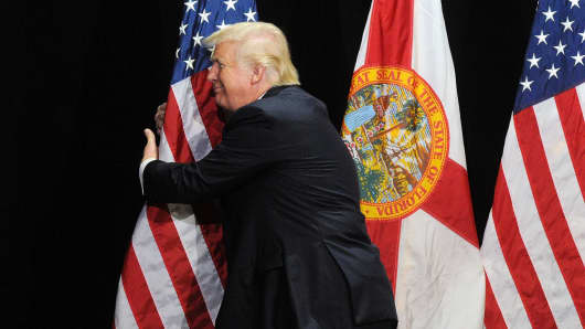 Donald Trump embraces the flag during a campaign rally in Tampa., Fla., on June 11, 2016.