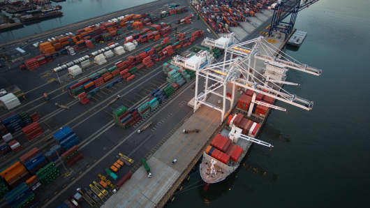 Shipping containers and a cargo ship are seen at the Port Jersey Marine Terminal.