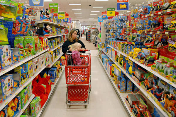 Customer with two-year-old shop in the toy section of a Super Target store in Littleton, Colorado.