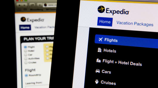 The Expedia homepage is displayed on laptop computers arranged for a photograph in Washington, D.C., U.S.