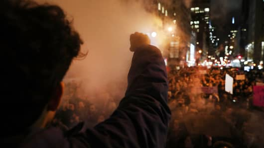 Thousands of anti-Trump protesters shut down 5th Avenue in front of Trump Tower as New Yorkers react to the election of Donald Trump as president of the United States on November 9, 2016 in New York City.