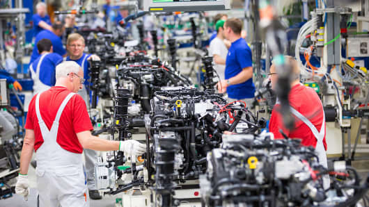 Employees work on the assembly line inside the Volkswagen factory in Wolfsburg, Germany, on May 20, 2016.