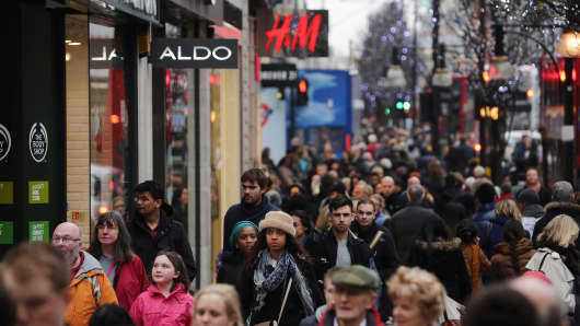 Shoppers make their way down Oxford Street
