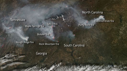 Wildfires burning in several states in the southern United States are seen in this natural-color satellite image collected by the Moderate Resolution Imaging Spectroradiometer (MODIS) aboard NASA's Aqua satellite November 12, 2016.
