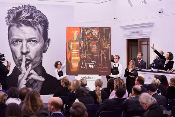 Sotheby's auctioneer Oliver Barker fields bids for Peter Lanyon's 'Witness' which sold for a record £797,000 at the white-glove sale of David Bowie's personal art collection on November 10, 2016 in London, England.