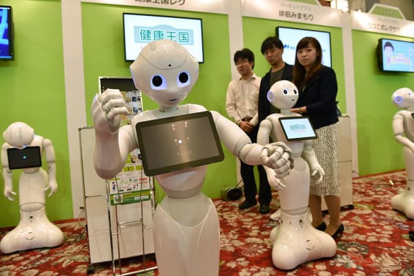 Humanoid robots made by Japan's telecom giant Softbank.