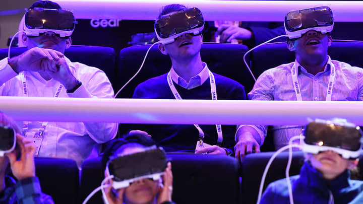 Attendees wear the Samsung Gear VR virtual reality headset at the Las Vegas Convention Center, January 5, 2016 in Las Vegas, Nevada ahead of the CES 2016 Consumer Electronics Show.