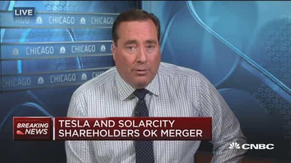 Tesla and SolarCity shareholders OK merger