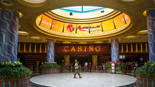 A visitor walks past the casino at Resorts World Sentosa in Singapore.
