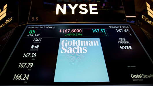 Goldman Sachs Group Inc. signage is displayed on a monitor on the floor of the New York Stock Exchange (NYSE) in New York, U.S., on Friday, Oct. 7, 2016.