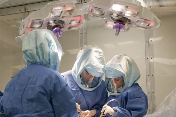 Dr. Friedrich Boettner performing total knee replacement surgery.