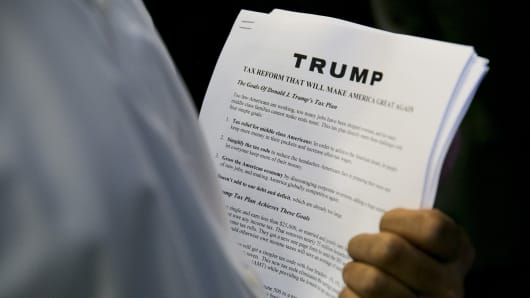 Media handouts describing the tax plan of Republican presidential hopeful Donald Trump's tax plan are viewed during a press conference at Trump Tower in New York on September 28, 2015.