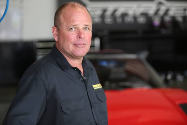 Eric Hutchison runs Electric GT, a car company that converts gas-powered luxury cars into electric vehicles.
