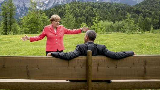 Chancellor Angela Merkel speaks with President Barack Obama outside the Elmau castle in Kruen near Garmisch-Partenkirchen, Germany.