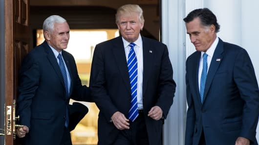 Vice president-elect Mike Pence, President-elect Donald Trump and Mitt Romney leave the clubhouse after their meeting at Trump International Golf Club, November 19, 2016 in Bedminster Township, New Jersey.